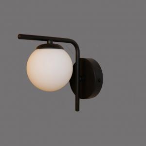 """מנורת קיר מחומר פליז בצבע שחור, זכוכית חלבית קוטר 10 ס""""מ, גוף התאורה עבודת יד מבית רנאור עיצובי תאורה, ניתן לקבל כל גודל וכל צבע לפי דרישה."""